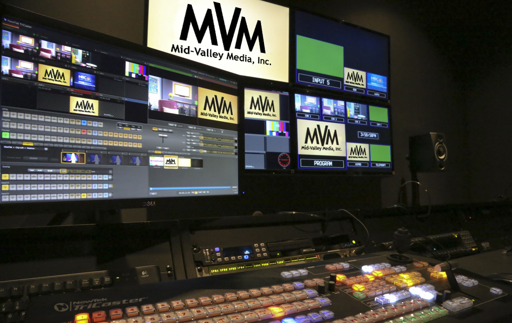 Mid-Valley Media Production room setup with multiple monitors and a tricaster